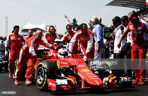 Sebastian Vettel of Germany and Ferrari is pushed into position on the grid before the Formula One Grand Prix of Mexico at Autodromo Hermanos...