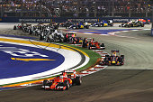 Sebastian Vettel of Germany and Ferrari leads Daniel Ricciardo of Australia and Infiniti Red Bull Racing Kimi Raikkonen of Finland and Ferrari Daniil...