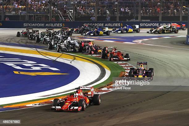 Sebastian Vettel of Germany and Ferrari leads Daniel Ricciardo of Australia and Infiniti Red Bull Racing Kimi Raikkonen of Finland and Ferrari Daniil...
