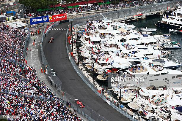 Sebastian Vettel of Germany and Ferrari leads from Lewis Hamilton of Great Britain and Mercedes GP during the Monaco Formula One Grand Prix at...