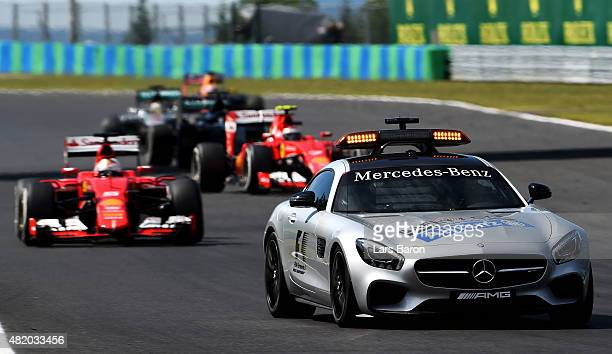 Sebastian Vettel of Germany and Ferrari leads the field behind the safety car during the Formula One Grand Prix of Hungary at Hungaroring on July 26...