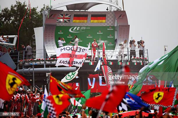 Sebastian Vettel of Germany and Ferrari Lewis Hamilton of Great Britain and Mercedes GP and Nico Rosberg of Germany and Mercedes GP celebrate on the...