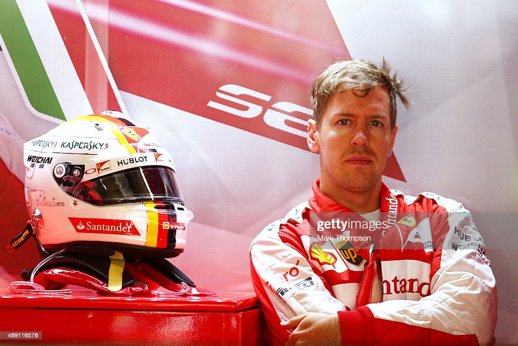 Sebastian Vettel of Germany and Ferrari looks on from the team garage during practice for the Formula One Grand Prix of China at Shanghai International Circuit on April 10, 2015 in Shanghai, China.