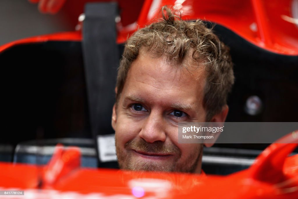 Sebastian Vettel of Germany and Ferrari looks on in the garage during a rain delayed final practice for the Formula One Grand Prix of Italy at Autodromo di Monza on September 2, 2017 in Monza, Italy.