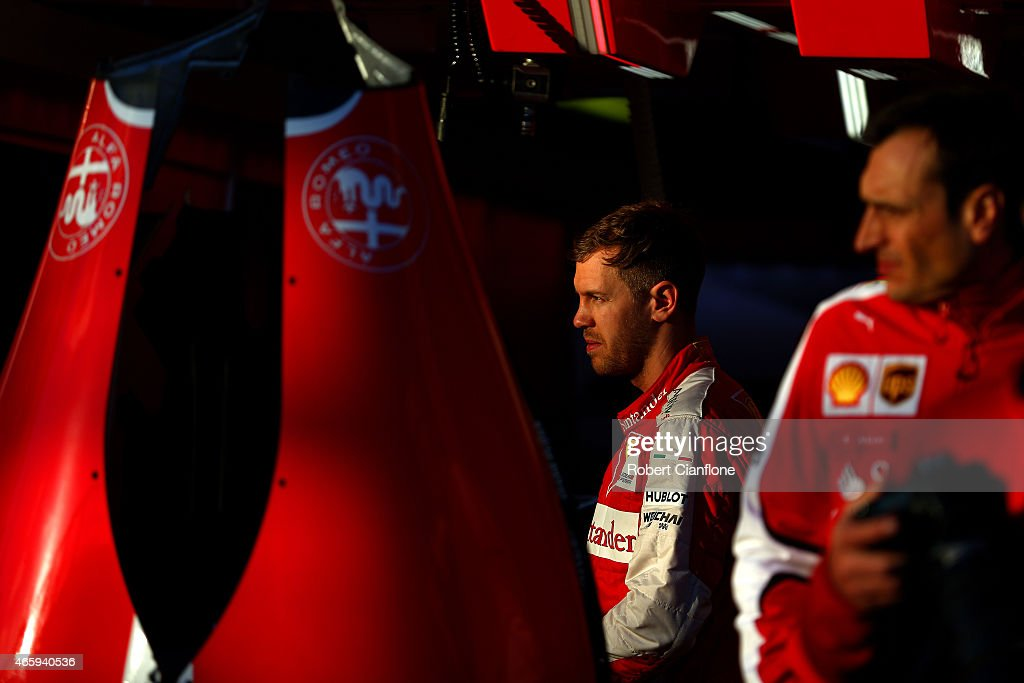 Sebastian Vettel of Germany and Ferrari looks on outside the garage during previews to the Australian Formula One Grand Prix at Albert Park on March 12, 2015 in Melbourne, Australia.
