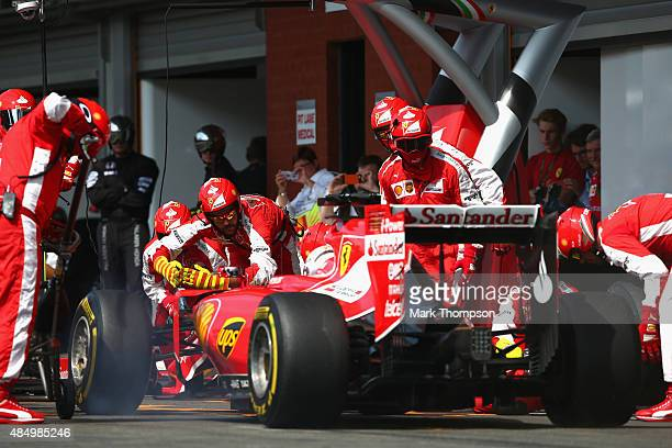 Sebastian Vettel of Germany and Ferrari makes a pit stop during the Formula One Grand Prix of Belgium at Circuit de SpaFrancorchamps on August 23...