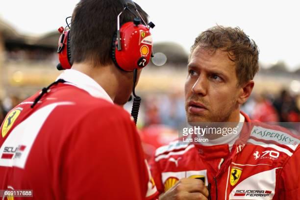 Sebastian Vettel of Germany and Ferrari on the grid before the Bahrain Formula One Grand Prix at Bahrain International Circuit on April 16 2017 in...