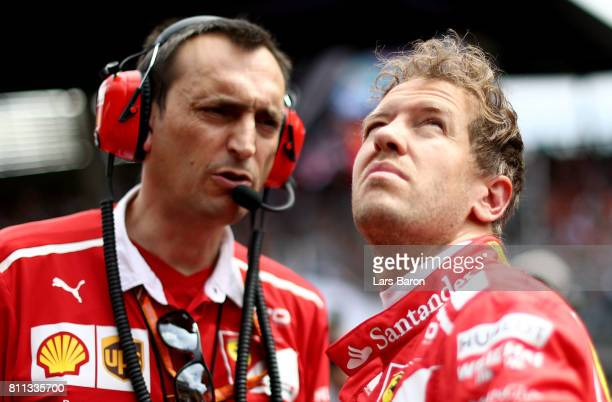 Sebastian Vettel of Germany and Ferrari prepares for the race on the grid during the Formula One Grand Prix of Austria at Red Bull Ring on July 9...