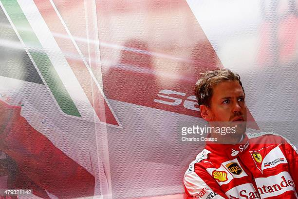 Sebastian Vettel of Germany and Ferrari prepares in the garage during practice for the Formula One Grand Prix of Great Britain at Silverstone Circuit...