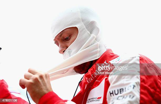 Sebastian Vettel of Germany and Ferrari prepares onthe grid before the Formula One Grand Prix of Austria at Red Bull Ring on June 21 2015 in...