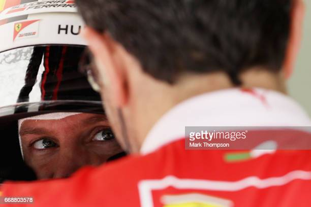 Sebastian Vettel of Germany and Ferrari prepares to drive in the garage during final practice for the Bahrain Formula One Grand Prix at Bahrain...