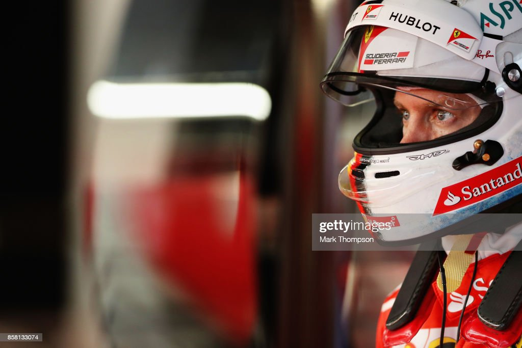 Sebastian Vettel of Germany and Ferrari prepares to drive in the garage during practice for the Formula One Grand Prix of Japan at Suzuka Circuit on October 6, 2017 in Suzuka.