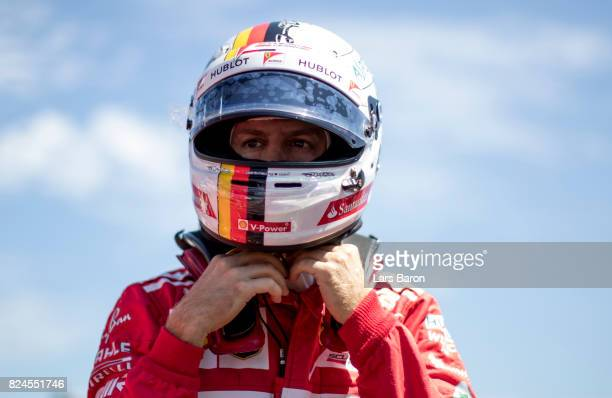 Sebastian Vettel of Germany and Ferrari prepares to drive on the grid before the Formula One Grand Prix of Hungary at Hungaroring on July 30 2017 in...