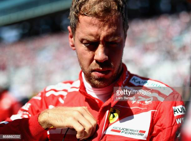 Sebastian Vettel of Germany and Ferrari prepares to drive on the grid before the Formula One Grand Prix of Japan at Suzuka Circuit on October 8 2017...