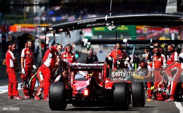 Sebastian Vettel of Germany and Ferrari returns to the garage during practice for the Formula One Grand Prix of Belgium at Circuit de...