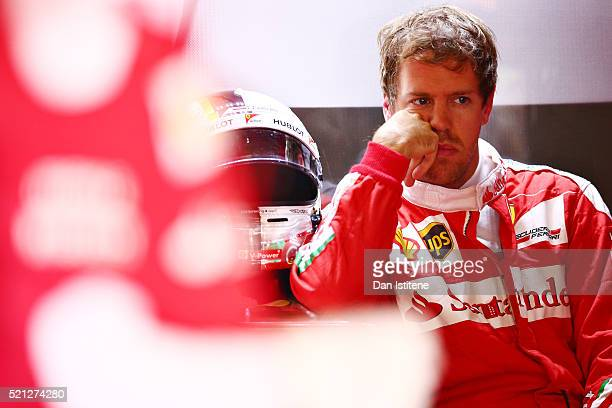 Sebastian Vettel of Germany and Ferrari sits in the back of his garage during practice for the Formula One Grand Prix of China at Shanghai...