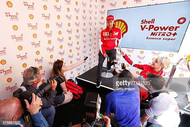 Sebastian Vettel of Germany and Ferrari speaks to the guests at the Shell VPower Nitro Fan Fest on Crescent Street ahead of the Canadian Formula One...