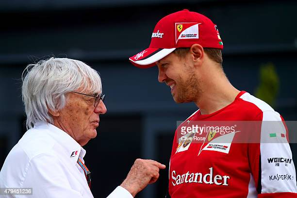 Sebastian Vettel of Germany and Ferrari speaks with F1 supremo Bernie Ecclestone in the paddock after qualifying for the Formula One Grand Prix of...
