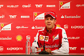 Sebastian Vettel of Germany and Ferrari speaks with members of the media at a press conference during day one of Formula One Winter Testing at...