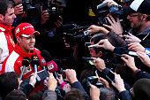 Sebastian Vettel of Germany and Ferrari speaks with members of the media in the paddock during day two of Formula One Winter Testing at Circuito de...