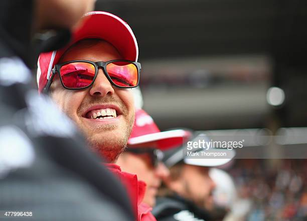 Sebastian Vettel of Germany and Ferrari takes part in the drivers' parade before the Formula One Grand Prix of Austria at Red Bull Ring on June 21...