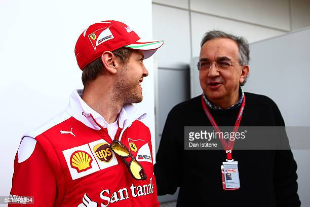 Sebastian Vettel of Germany and Ferrari talks to Sergio Marchionne CEO of FIAT and Chairman of Ferrari ahead of the Formula One Grand Prix of China...