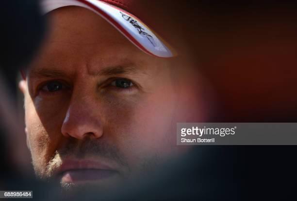 Sebastian Vettel of Germany and Ferrari talks to the media during qualifying for the Monaco Formula One Grand Prix at Circuit de Monaco on May 27...