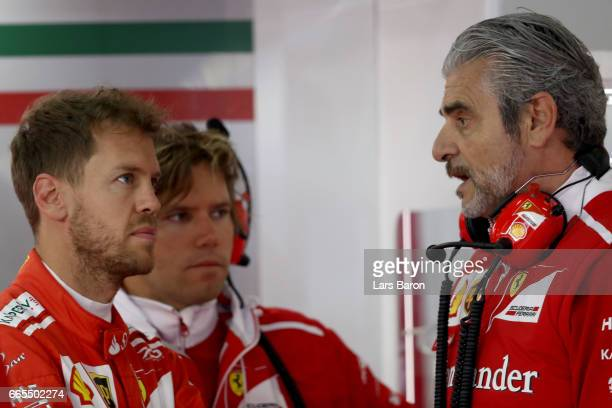 Sebastian Vettel of Germany and Ferrari talks with Ferrari Team Principal Maurizio Arrivabene in the garage during practice for the Formula One Grand...