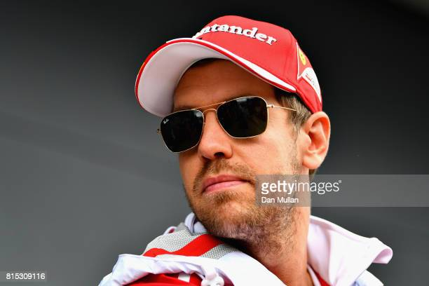 Sebastian Vettel of Germany and Ferrari walks in the Paddock before the Formula One Grand Prix of Great Britain at Silverstone on July 16 2017 in...