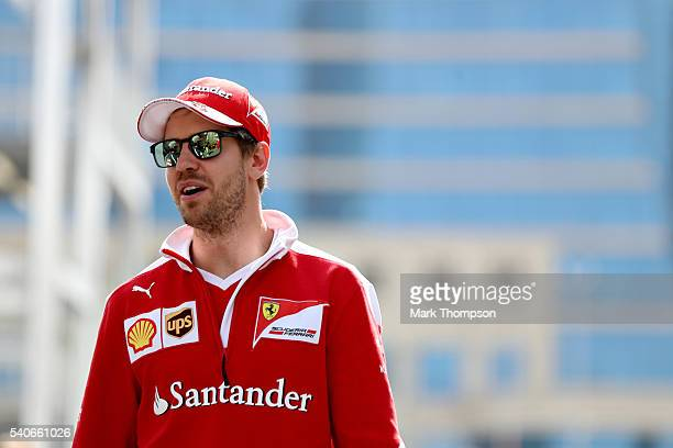 Sebastian Vettel of Germany and Ferrari walks in the Paddock during previews ahead of the European Formula One Grand Prix at Baku City Circuit on...