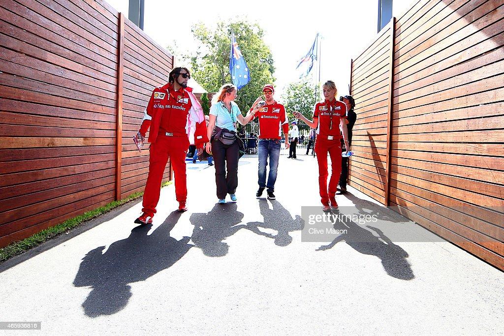Sebastian Vettel of Germany and Ferrari walks through the paddock during previews to the Australian Formula One Grand Prix at Albert Park on March 12...