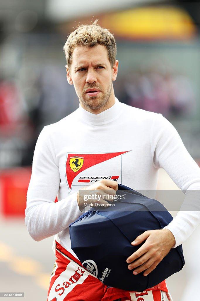 <a gi-track='captionPersonalityLinkClicked' href=/galleries/search?phrase=Sebastian+Vettel&family=editorial&specificpeople=2233605 ng-click='$event.stopPropagation()'>Sebastian Vettel</a> of Germany and Ferrari walks to the pits ahead of practice for the Monaco Formula One Grand Prix at Circuit de Monaco on May 26, 2016 in Monte-Carlo, Monaco.