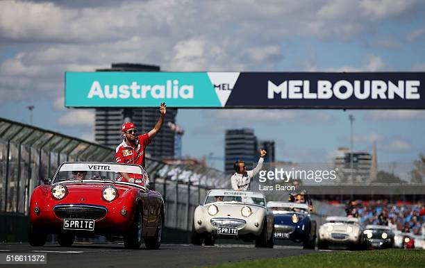 Sebastian Vettel of Germany and Ferrari waves to the crowd on the drivers parade ahead of the Australian Formula One Grand Prix at Albert Park on...