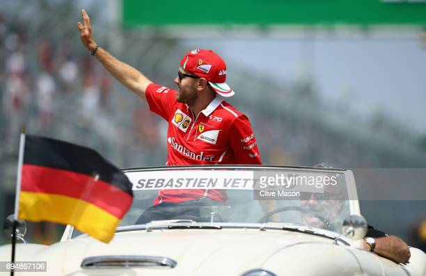 Sebastian Vettel of Germany and Ferrari waves to the crowd on the drivers parade during the Canadian Formula One Grand Prix at Circuit Gilles...