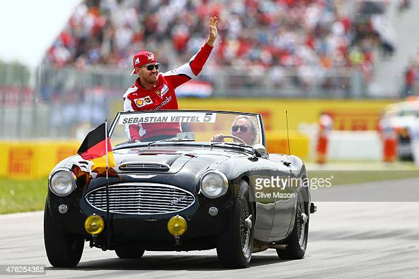 Sebastian Vettel of Germany and Ferrari waves to the fans prior to the Canadian Formula One Grand Prix at Circuit Gilles Villeneuve on June 7 2015 in...