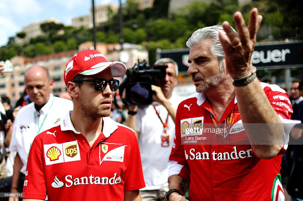 <a gi-track='captionPersonalityLinkClicked' href=/galleries/search?phrase=Sebastian+Vettel&family=editorial&specificpeople=2233605 ng-click='$event.stopPropagation()'>Sebastian Vettel</a> of Germany and Ferrari with Ferrari Team Principal <a gi-track='captionPersonalityLinkClicked' href=/galleries/search?phrase=Maurizio+Arrivabene&family=editorial&specificpeople=5666002 ng-click='$event.stopPropagation()'>Maurizio Arrivabene</a> in the Pitlane during previews to the Monaco Formula One Grand Prix at Circuit de Monaco on May 27, 2016 in Monte-Carlo, Monaco.