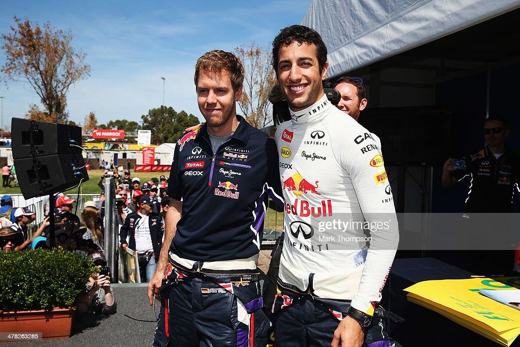 Sebastian Vettel of Germany and Infiniti Red Bull Racing and Daniel Ricciardo of Australia and Infiniti Red Bull Racing attend a signing session on...