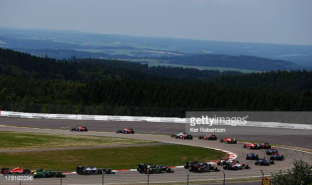 Sebastian Vettel of Germany and Infiniti Red Bull Racing and Mark Webber of Australia and Infiniti Red Bull Racing lead the field at the start of the...