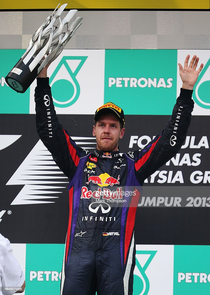 <a gi-track='captionPersonalityLinkClicked' href=/galleries/search?phrase=Sebastian+Vettel&family=editorial&specificpeople=2233605 ng-click='$event.stopPropagation()'>Sebastian Vettel</a> of Germany and Infiniti Red Bull Racing celebrates on the podium after winning the Malaysian Formula One Grand Prix at the Sepang Circuit on March 24, 2013 in Kuala Lumpur, Malaysia.