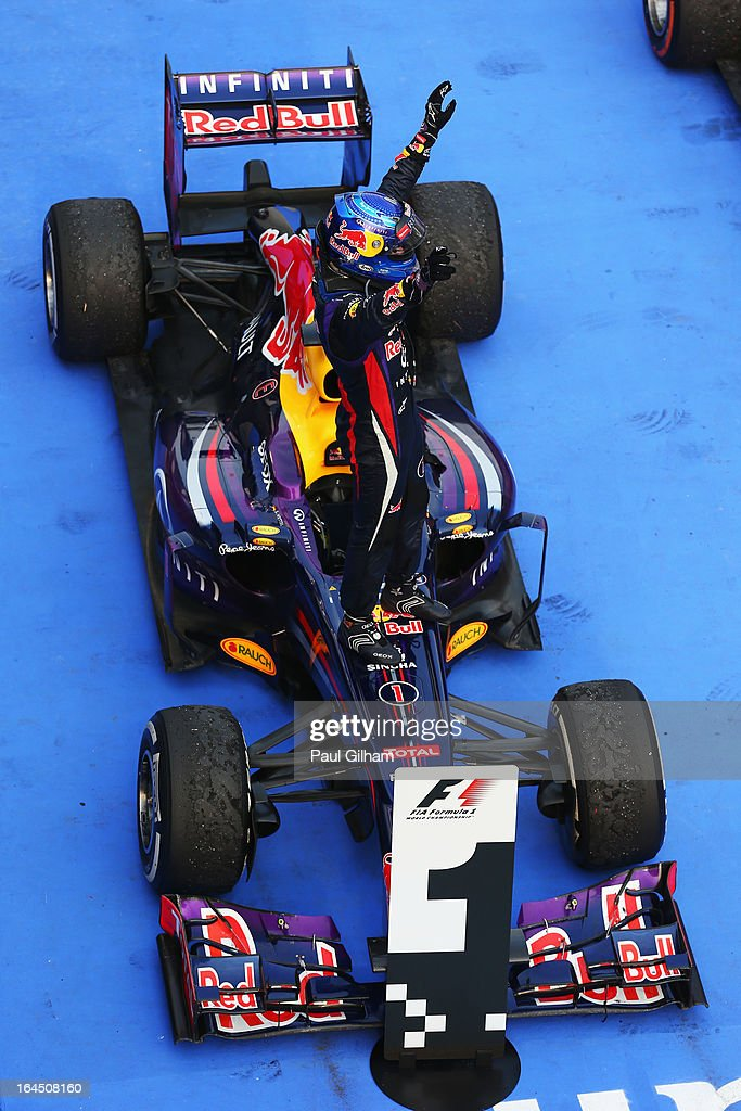 Sebastian Vettel of Germany and Infiniti Red Bull Racing celebrates in parc ferme after winning the Malaysian Formula One Grand Prix at the Sepang Circuit on March 24, 2013 in Kuala Lumpur, Malaysia.