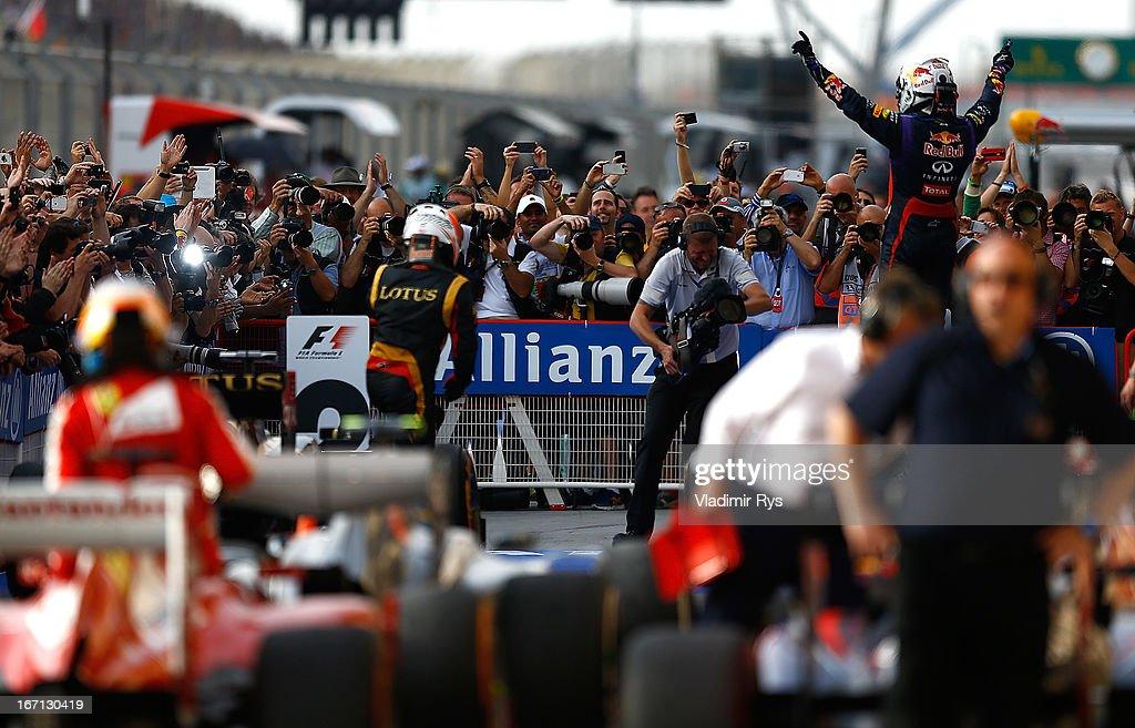 Sebastian Vettel of Germany and Infiniti Red Bull Racing celebrates after winning the Bahrain Formula One Grand Prix at the Bahrain International Circuit on April 21, 2013 in Sakhir, Bahrain.