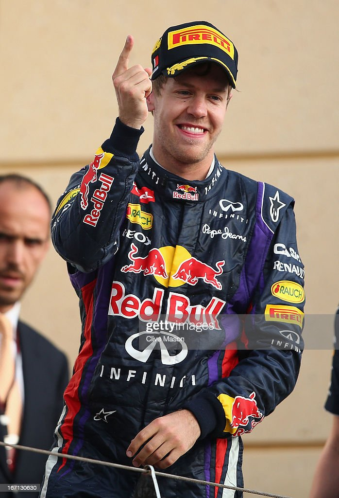 Sebastian Vettel of Germany and Infiniti Red Bull Racing celebrates on the podium after winning the Bahrain Formula One Grand Prix at the Bahrain International Circuit on April 21, 2013 in Sakhir, Bahrain.