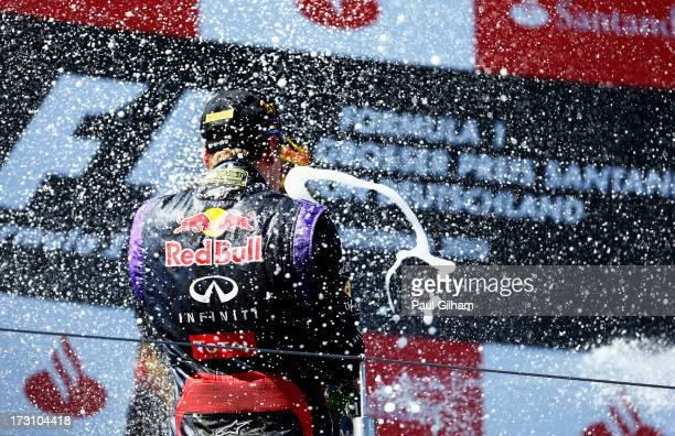 Sebastian Vettel of Germany and Infiniti Red Bull Racing celebrates on the podium after winning the German Grand Prix at the Nuerburgring on July 7...