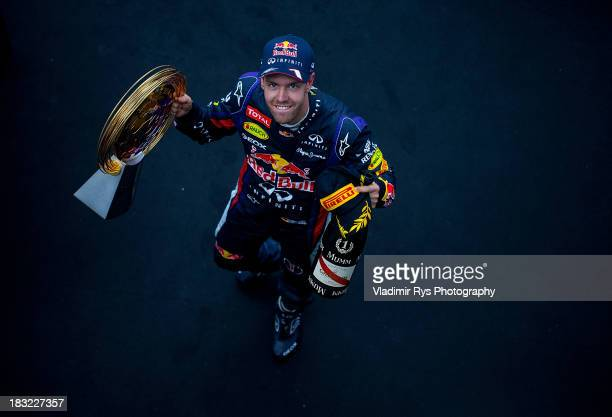 Sebastian Vettel of Germany and Infiniti Red Bull Racing celebrates on the podium after winning the Korean Formula One Grand Prix at Korea...
