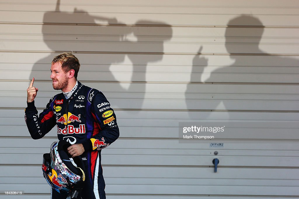 Sebastian Vettel of Germany and Infiniti Red Bull Racing celebrates in parc ferme after winning the Japanese Formula One Grand Prix at Suzuka Circuit on October 13, 2013 in Suzuka, Japan.