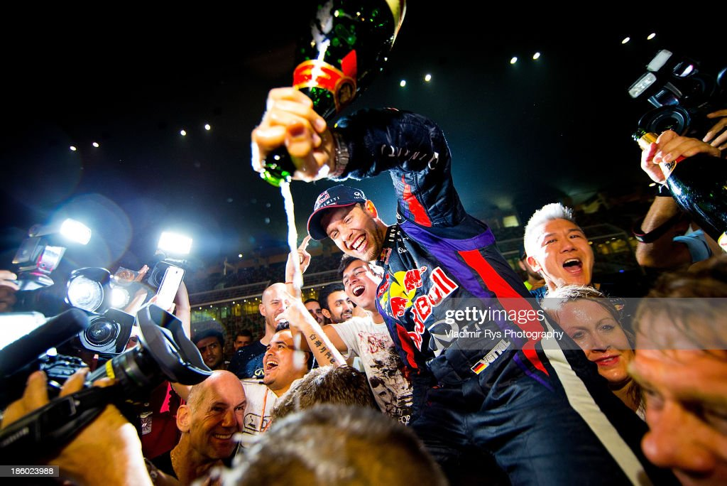 Sebastian Vettel of Germany and Infiniti Red Bull Racing celebrates with his team after winning the Indian Formula One Grand Prix at Buddh International Circuit on October 27, 2013 in Noida, India.