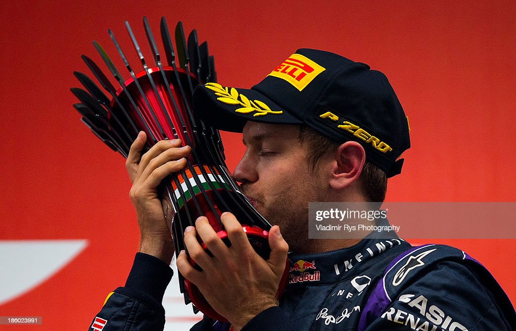 <a gi-track='captionPersonalityLinkClicked' href=/galleries/search?phrase=Sebastian+Vettel&family=editorial&specificpeople=2233605 ng-click='$event.stopPropagation()'>Sebastian Vettel</a> of Germany and Infiniti Red Bull Racing celebrates on the podium after winning the Indian Formula One Grand Prix at Buddh International Circuit on October 27, 2013 in Noida, India.