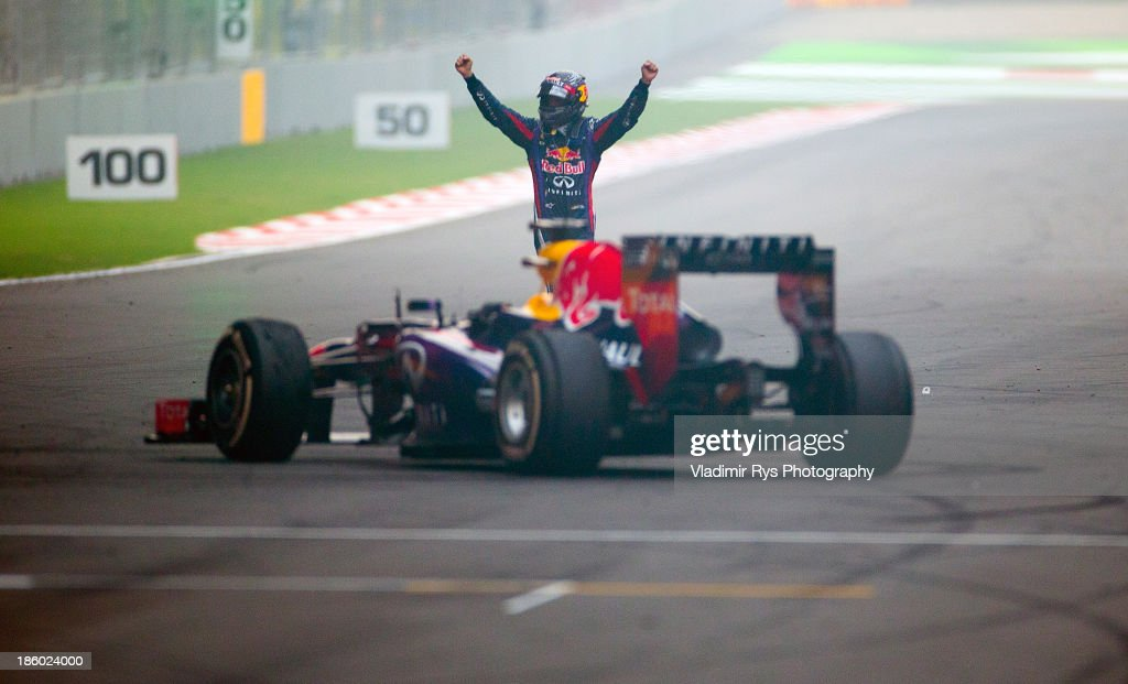 <a gi-track='captionPersonalityLinkClicked' href=/galleries/search?phrase=Sebastian+Vettel&family=editorial&specificpeople=2233605 ng-click='$event.stopPropagation()'>Sebastian Vettel</a> of Germany and Infiniti Red Bull Racing celebrates on the track after winning the Indian Formula One Grand Prix at Buddh International Circuit on October 27, 2013 in Noida, India.