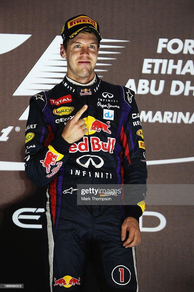Sebastian Vettel of Germany and Infiniti Red Bull Racing celebrates on the podium after winning the Abu Dhabi Formula One Grand Prix at the Yas Marina Circuit on November 3, 2013 in Abu Dhabi, United Arab Emirates.