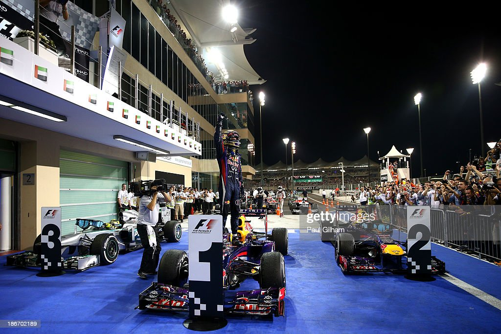 <a gi-track='captionPersonalityLinkClicked' href=/galleries/search?phrase=Sebastian+Vettel&family=editorial&specificpeople=2233605 ng-click='$event.stopPropagation()'>Sebastian Vettel</a> of Germany and Infiniti Red Bull Racing celebrates in parc ferme after winning the Abu Dhabi Formula One Grand Prix at the Yas Marina Circuit on November 3, 2013 in Abu Dhabi, United Arab Emirates.